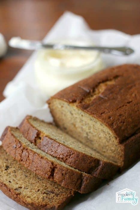 A loaf of bread slices half way.