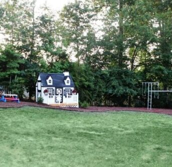 A playhouse in a back yard.