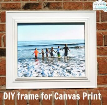 A framed canvas print of children on the beach with text below it.