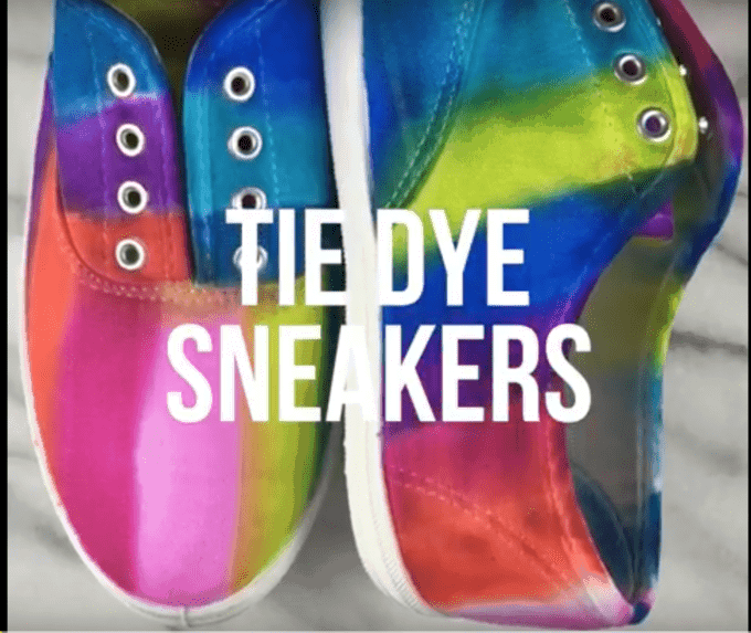 A close up of tie dye sneakers.