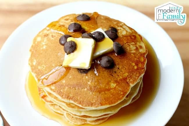 Stack of  Pancakes with blueberries, butter and syrup.
