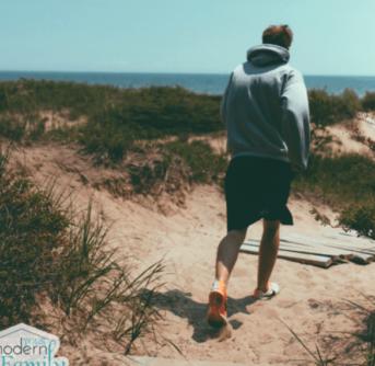 A man jogging near the beach.