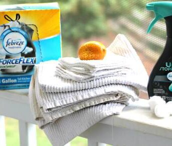 Cleaning products sitting on a porch railing.
