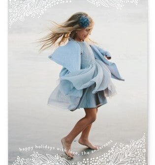 A girl in a blue dress dancing.