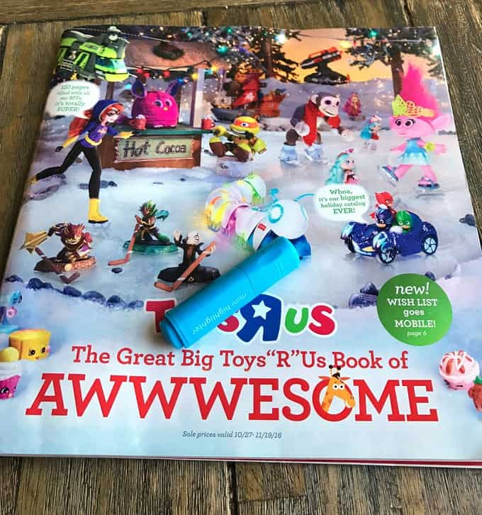 A Toys R Us catalog sitting on a table.