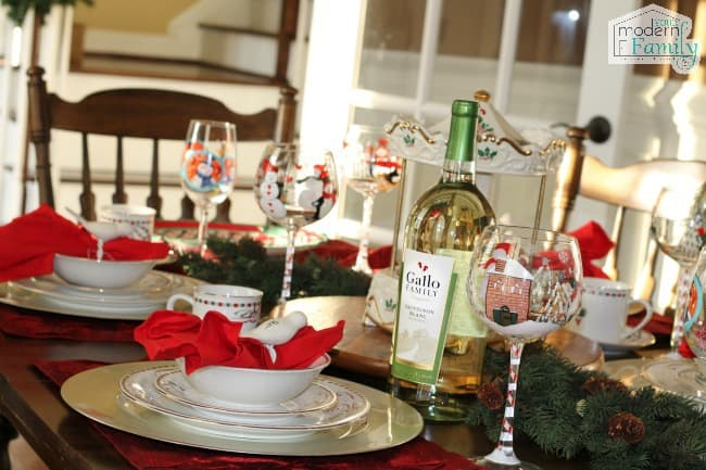 A table topped with plates of food and wine glasses.