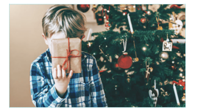 Child holding one of the 4 christmas gift idea