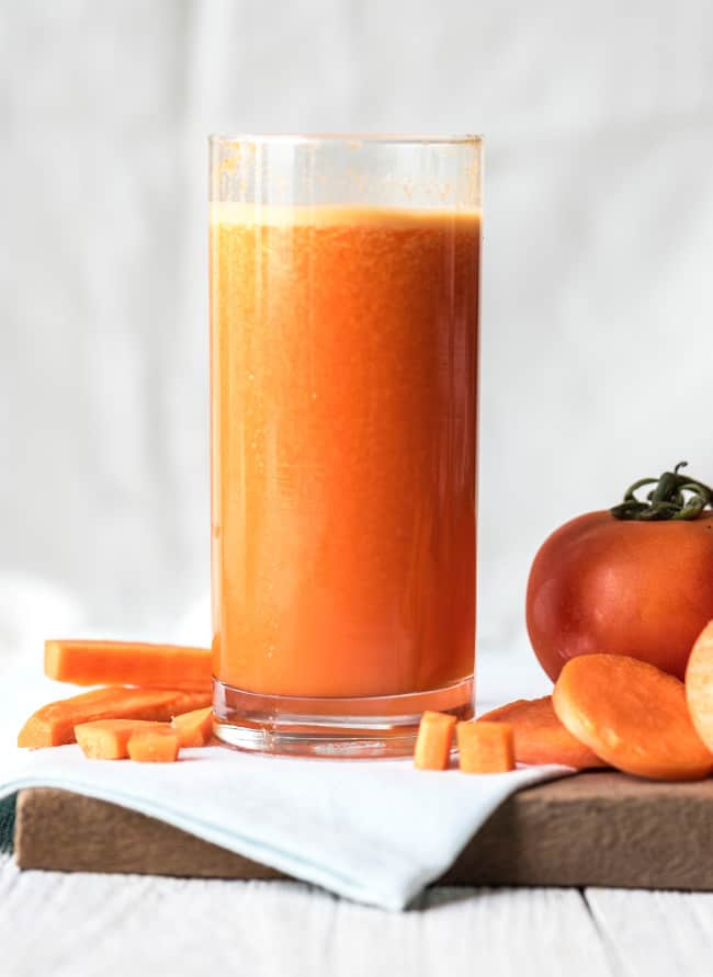 A glass of orange juice, with Fruit and Carrot