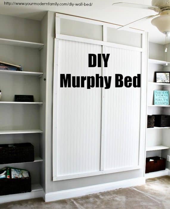 A bedroom with a Murphy Bed hidden away in the wall.