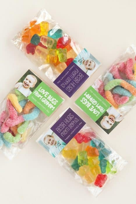 Bags of gummy bears and gummy worms with pictures of babies and text.