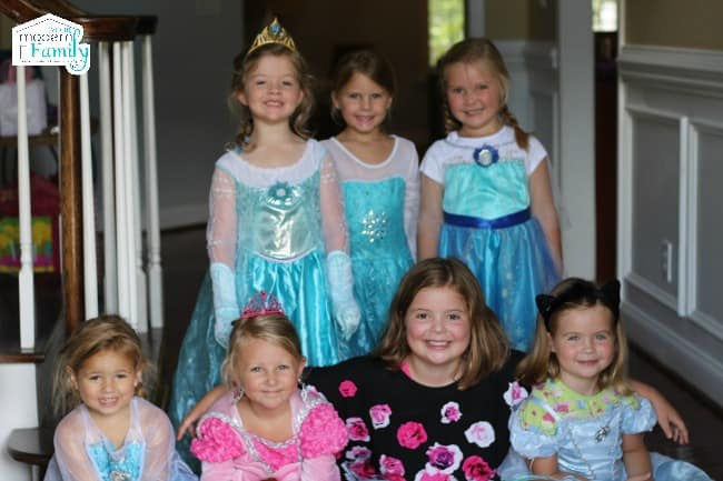 Little girls posing for a photo in princess costumes.