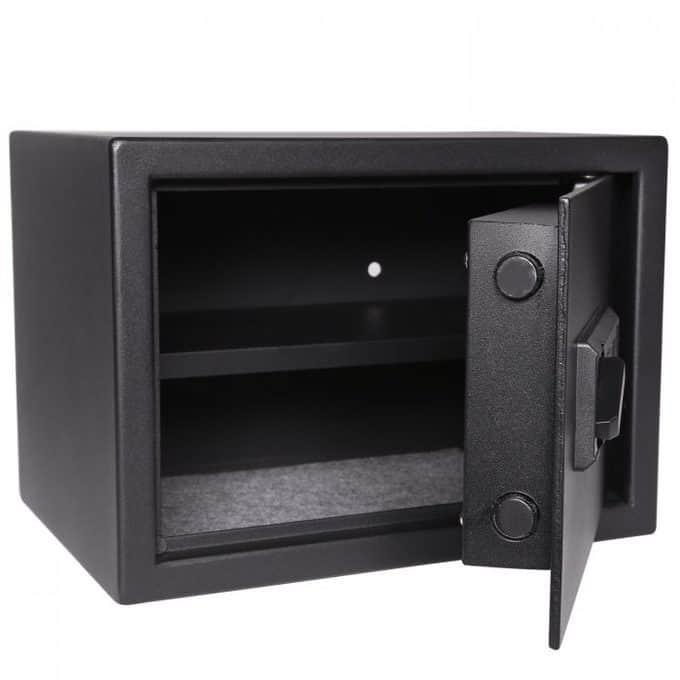 A close up of an open metal safe.