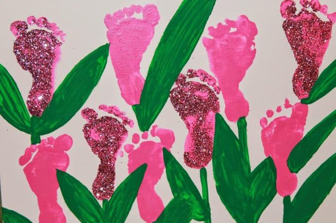 A close up of painted  flowers made from children\'s footprints.