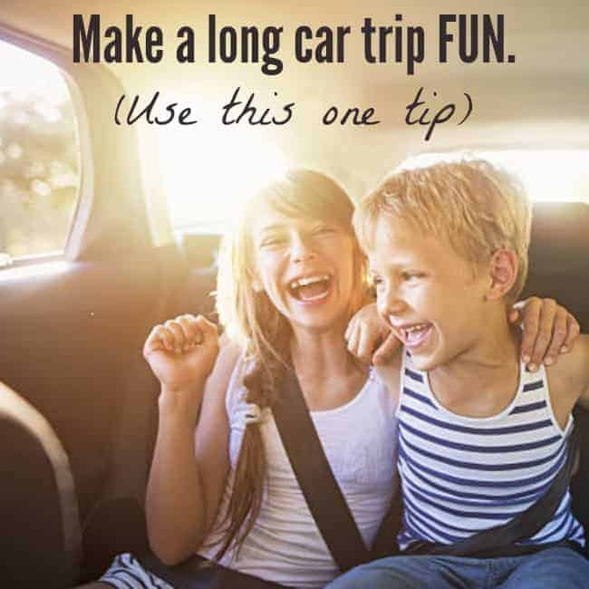 Two kids sitting in a car laughing with text above them.