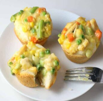 A plate of mini Chicken Pot Pie muffins on a white plate.