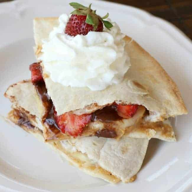A Banana split quesadilla on a white plate.