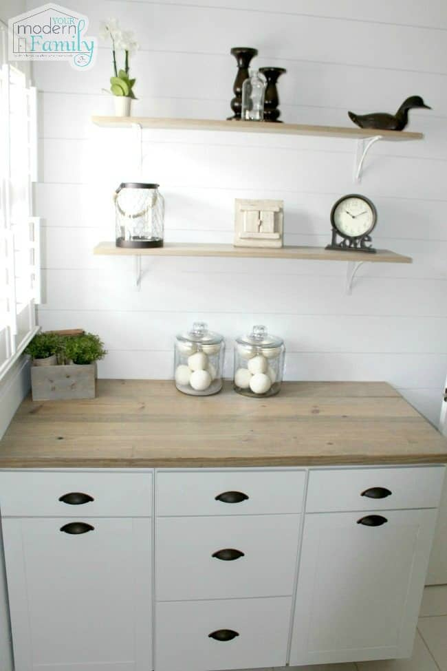 A counter with drawers and shelves above it.