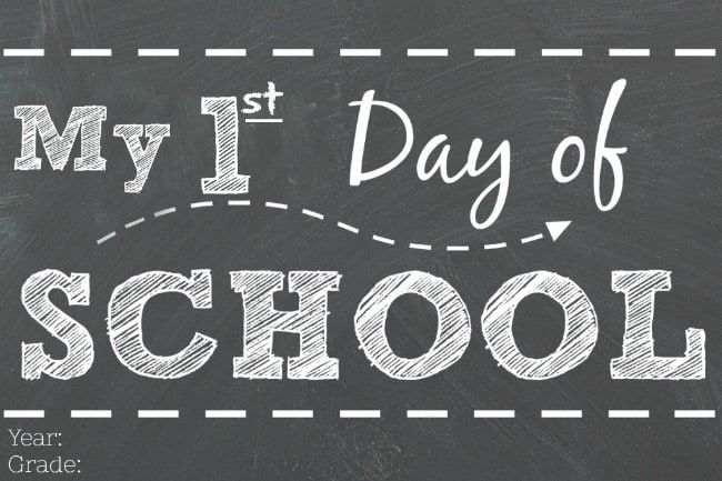 A chalk board with a first day of school message.