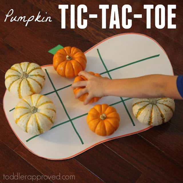 Boy playing  Tic-tac-toe with gourds.