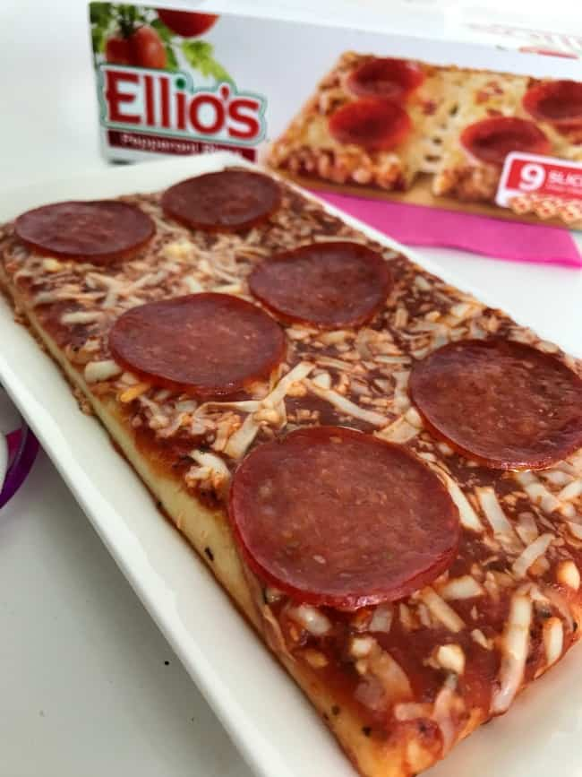 A close up of a slice of Ellio\'s pizza.