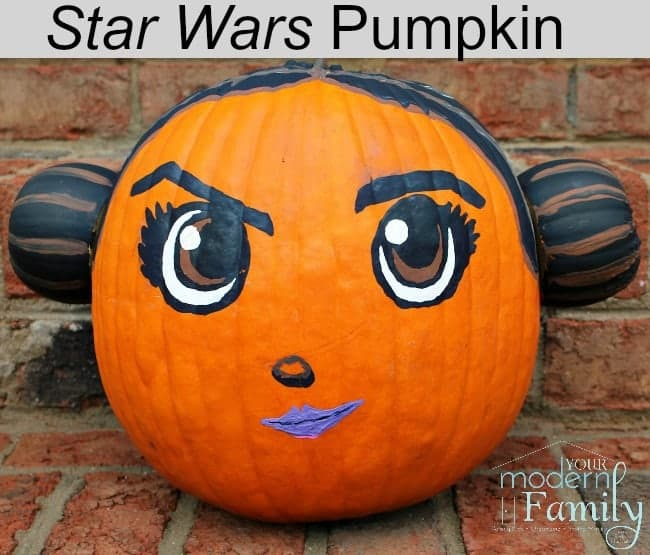 A pumpkin decorated  as Princess Leia.