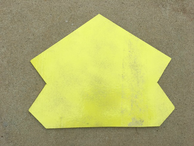 A piece of cardboard painted yellow.