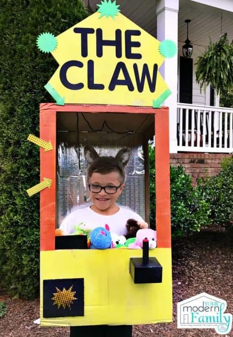 A boy dressed in a Claw game Halloween costume.