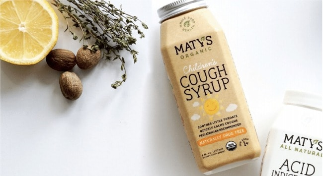A bottle of Matys cough syrup lying on a counter.