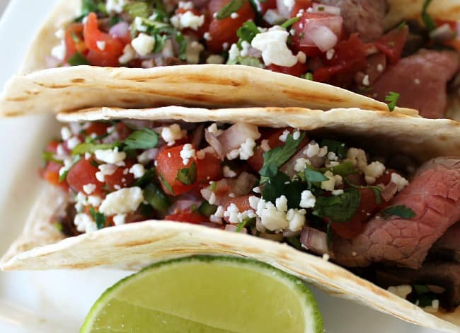 A plate of Steak Tacos .