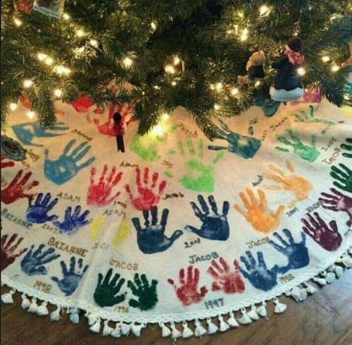 Christmas tree skirt with children's hand prints.