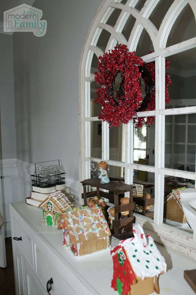 Christmas decorations sitting on a dining room buffet.