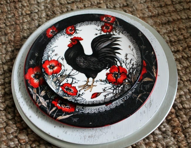 A plate with a rooster painted on it.