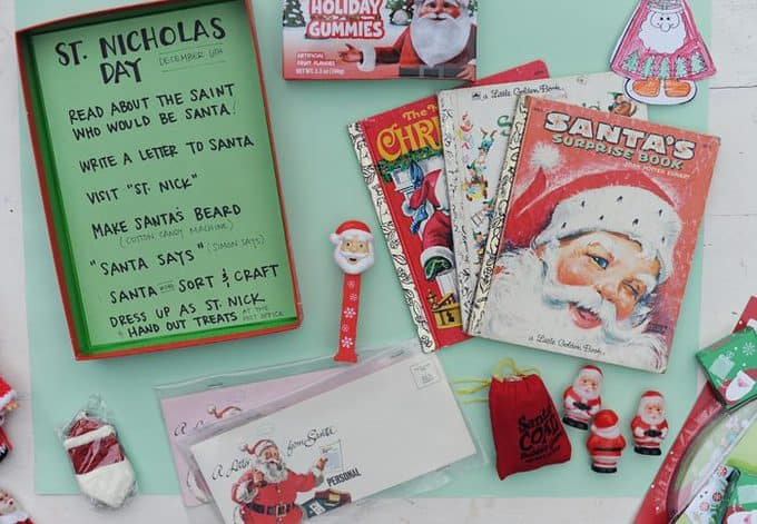 A stack of Christmas books and prizes on a table