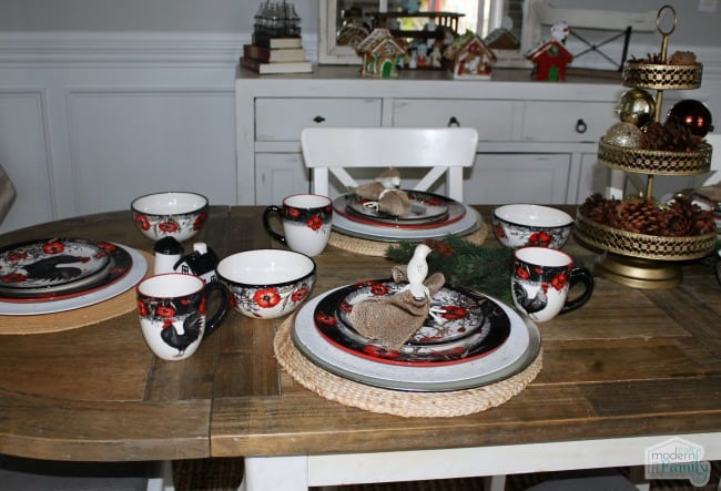A kitchen with with plates and cup settings.