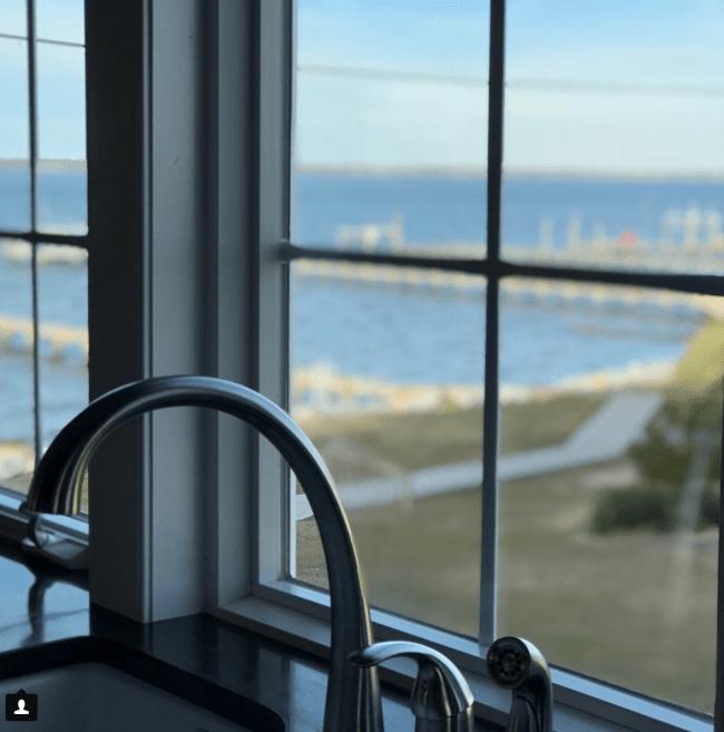 A view of the ocean through a window.