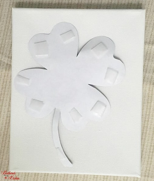 A picture showing the back side of a cut out shape with tape attached to it.