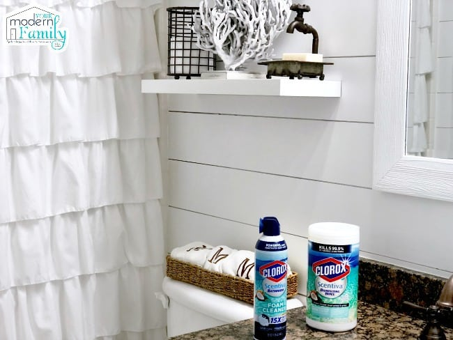 A bottle of Clorox foaming cleaner and a container of Clorox wipes sitting on a bathroom counter.