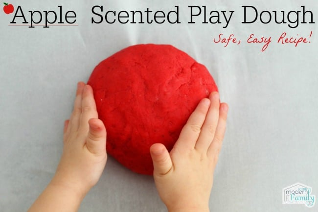 Red play dough with text above it.