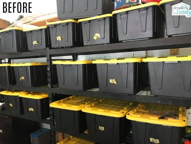 A close up of shelves of organized black plastic containers.