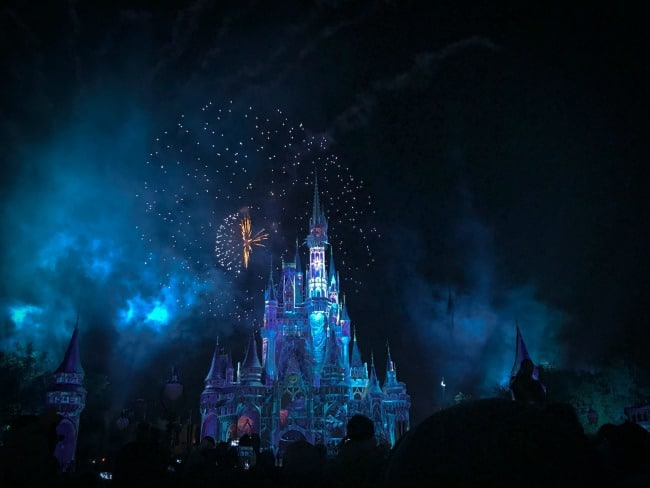 Night time view of Cinderella\'s castle.