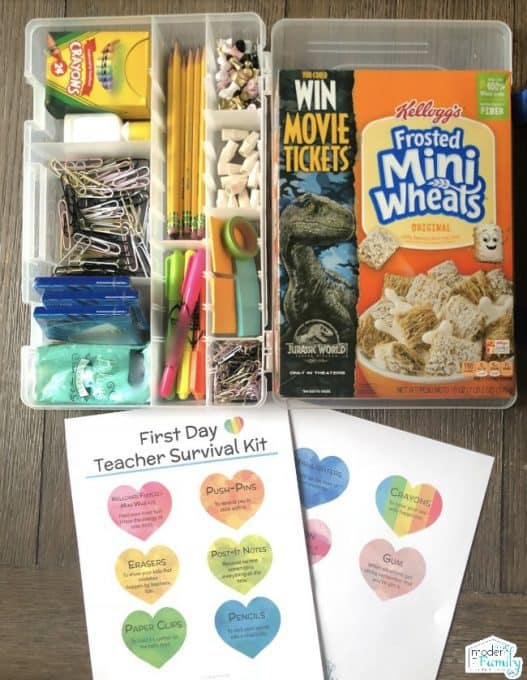 A variety of school supplies in plastic containers beside a box of Mini Wheats.