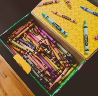 An open crayon box of crayons inside.