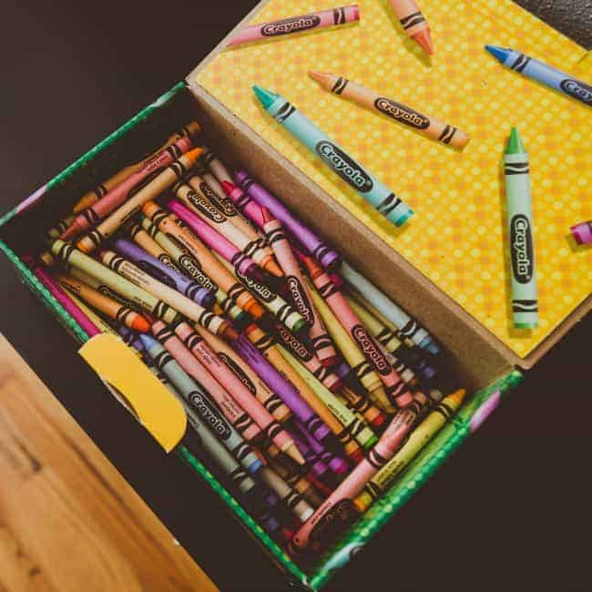 an open school box with crayons in it - rainbow writing sight words