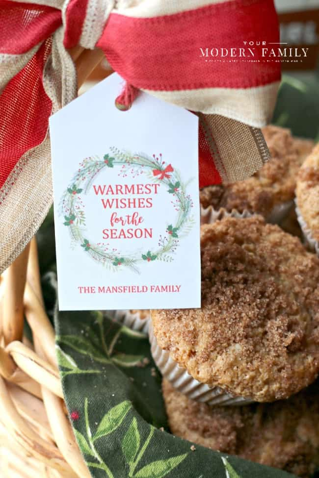 A close up of a gift tag on a basket of muffins.