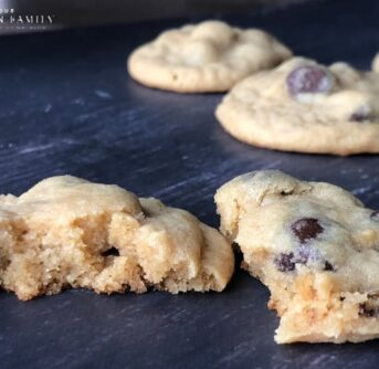 Homemade chocolate chip cookies on a wooden table.