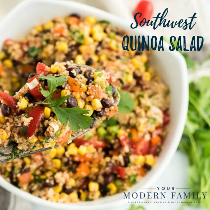 A bowl of food on a plate, with Quinoa and Salad