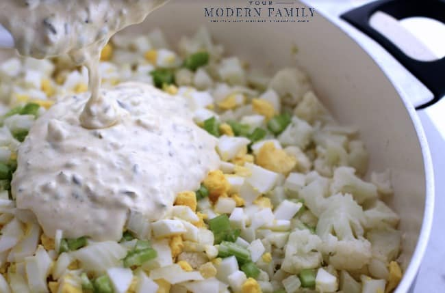 A close up of a bowl of cauliflower rice and vegetables.