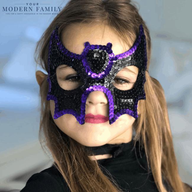A girl wearing a Halloween mask.