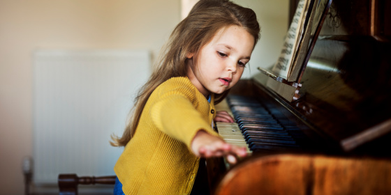piano lessons for kids - child at piano
