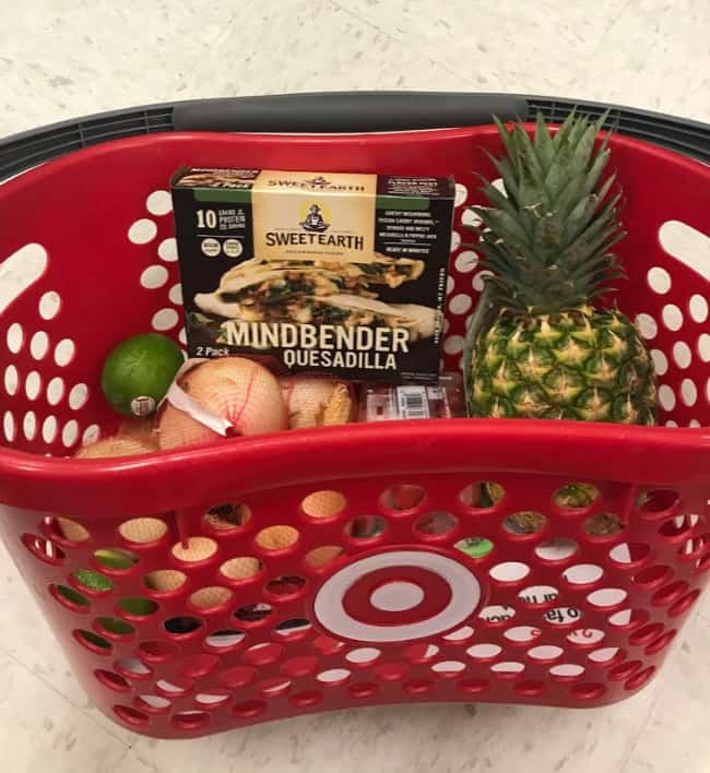 A Target shopping basket with fruits and vegetables in it.
